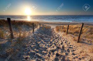 26735309-sunshine-over-path-to-beach-in-north-sea-zandvoort-north-holland-netherlands-stock-photo